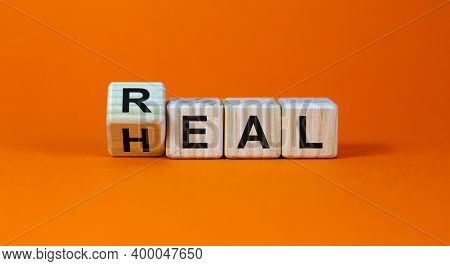 Real Heal Symbol. Fliped A Wooden Cube With Words 'real Heal'. Beautiful Orange Background, Copy Spa