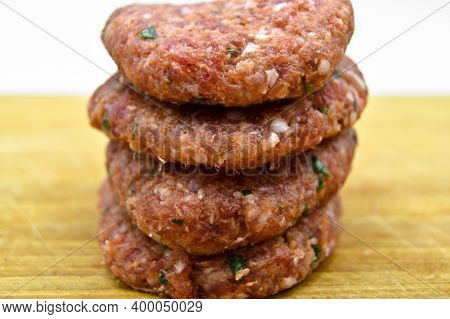 Raw Beef Meatballs Made With Various Homemade Spices, Beef Kofte Kofta Raw, On Bamboo Cutting Board