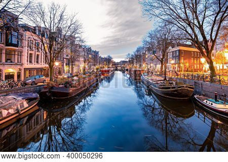 Amsterdam Canals In The Evening Light, Dutch Canals In Amsterdam Holland Netherlands During Winter T