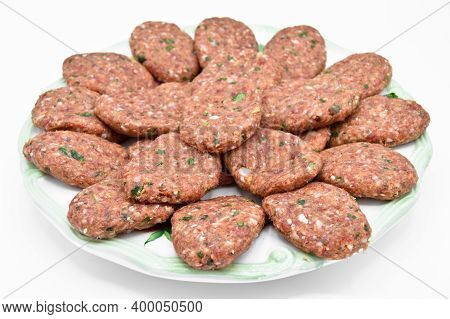Raw Beef Meatballs Made With Various Homemade Spices, Beef Kofte Kofta Raw, In A White Plate