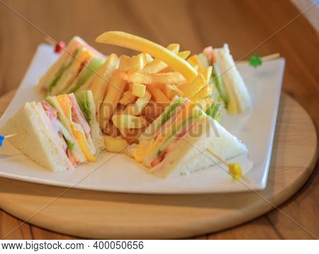 French Fries And  Club Sandwiches In The Plate. Delicious Club Sandwich With French Fries At A Diner