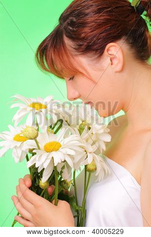 Pretty Young Girl With Chamomile Flowers