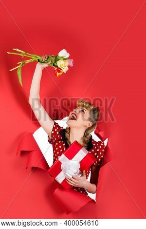 Ad. Pin Up Girl With Flowers. Smiling Retro Woman Hold Flowers Through Hole In Paper. Woman Through