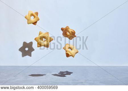 Levitating Cookies In The Shape Of A Hexagonal Star Of David. Hexagram.