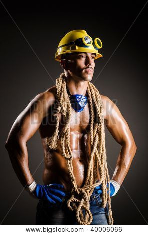 Construction worker in dark studio