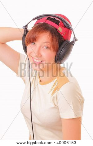 Smiling Young Girl Listening To Music With Headphones
