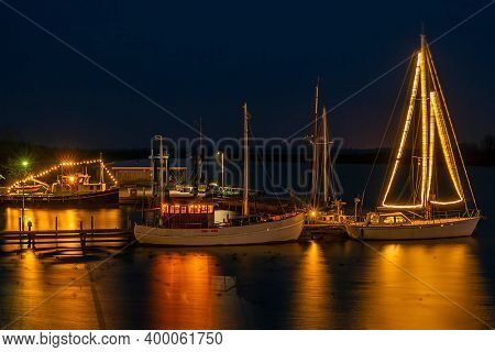 Decorated sailing boats in the harbor from Lauwersoog in the Netherlands