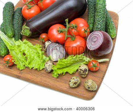 Eggs, Eggplant And Other Vegetables On A White Background