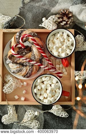 Two Red Cups With Hot Chocolate Or Cocoa Drink On A Wooden Board With Festive Winter Decorations.win