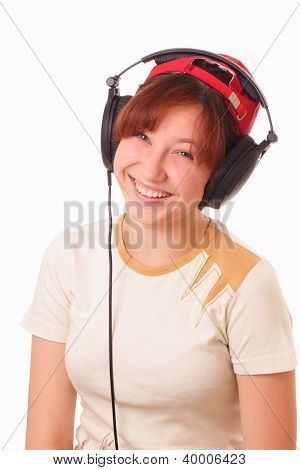 Smiling Young Girl Listening To Music On Headphones