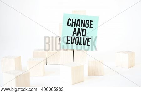 Text Change And Evolve Writing In Green Card Cube Ladder. White Background. Business Concept