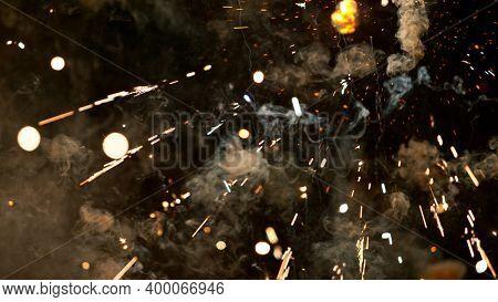 Fireworks background with blurred lights on black background