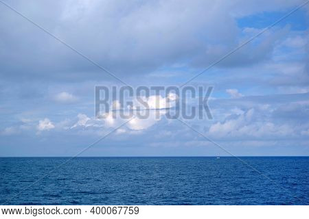 Ocean landscape with clouds on horizon. Atlantic Ocean