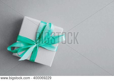 The Gray Gift Box Is Tied With A Mint Satin Ribbon. Gray Is The Popular Color Of 2021. A Festive Com