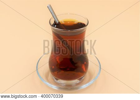 Traditional Turkish Tea In Glas Cup Background.