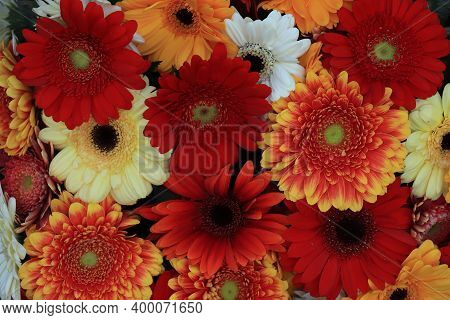 Mixed Flower Arrangement: Various Gerberas In Different Colors For A Wedding