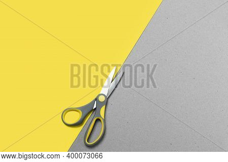 Two-tone Paper Background With Scissors In Trending Color Combinations Of 2021. Trend Colors Of 2021