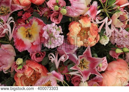 Various Pink And Purple Flowers In A Floral Wedding Arrangement