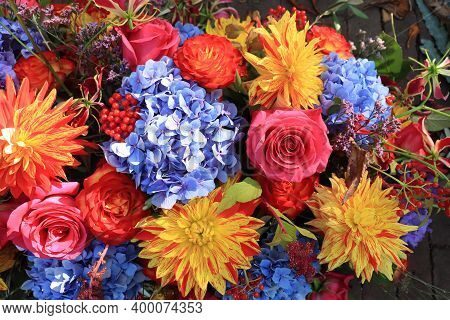 Autumn Wedding Flower Arrangement In Bright Colors