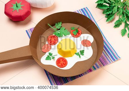 Realistic Paper Fried Eggs With Tomatoes And Sausage In Frying Pan. Ingredients For Fried Eggs On Ta
