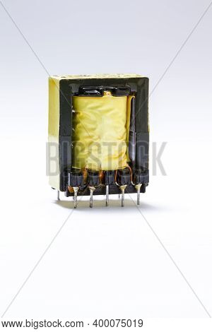 Electronics Concepts. Closeup Image Of Powerful Alternative Current Voltage Transformer In Yellow Is