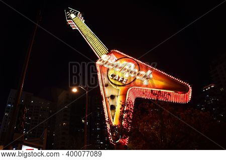 Chicago, Il May 23, 2020, Hard Rock Cafe Red And Yellow Neon Sign In The Shape Of A Guitar At Night