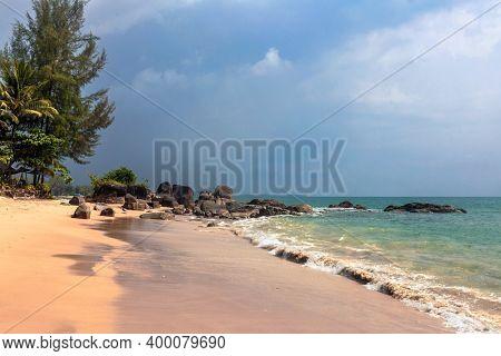 Tropical beach in gloomy weather day. Khao Lak province, Thailand.