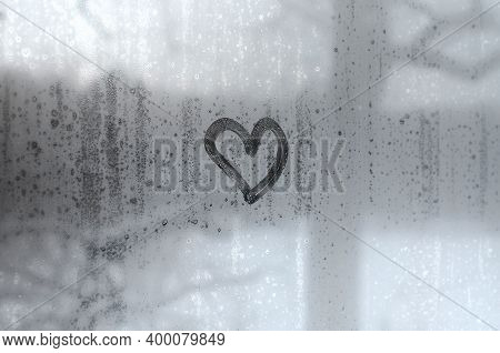 The Heart Is Painted On The Misted Glass In Winter