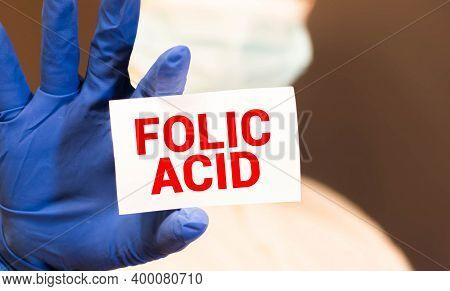 Folic Acid Card In Hands Of Medical Doctor.