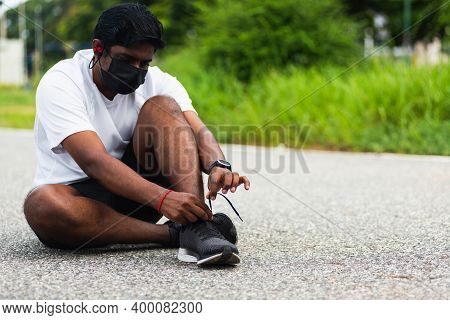 Close Up Asian Sport Runner Black Man Wear Face Mask Protective He Shoelace Trying Running Shoes Get