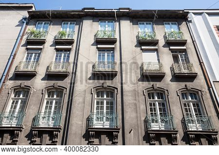 Typical Facade Of An Old Residential Building In Vracar District With A Grey Polluted Wall In The Ci