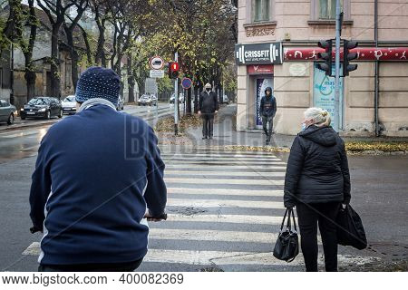 Belgrade, Serbia - November 17, 2020: Old Senior Man Wearing A Respiratory Face Mask Waiting To Cros