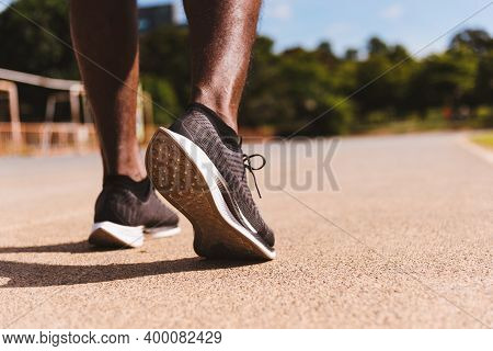 Asian Young Athlete Sport Runner Black Man Wear Feet Active Ready To Running Training At The Outdoor