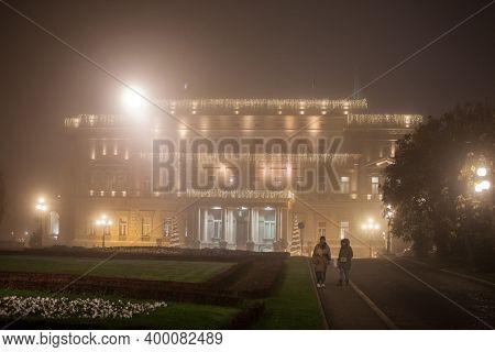 Belgrade, Serbia - November 26, 2020: People Walking In Front Of Stari Dvor, The City Hall Of Belgra