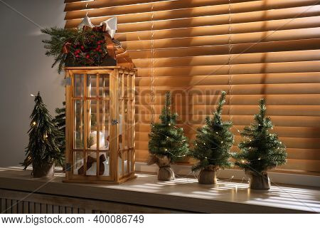 Beautiful Christmas Lantern On Windowsill In Decorated Room