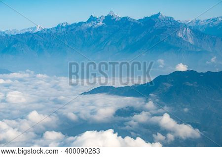 Spectacular View Of Himalayas Mountain Range Look Through The Airplane Window. Himalayas Is Great Mo