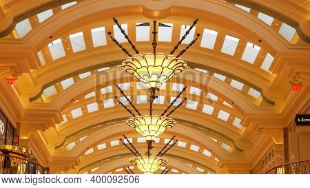 Las Vegas, Nevada, United States - December 23, 2019: Luxury interior lamps on a curved roof inside the  Wynn luxury shopping mall at Wynn Hotel Resort in Las Vegas, Nevada.