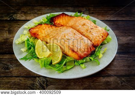 Baked Salmon Fillet With Green Salad On Gray Plate. Healthy Food.