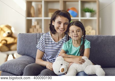 Portrait Of Happy Kid Girl And Smiling Mother Looking At Camera Webcam Making Online Call.