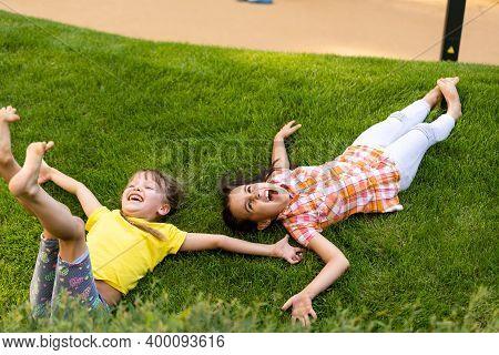 Portrait Of Two Little Girls Sisters Fighting On Home Backyard. Friends Girls Having Fun. Lifestyle