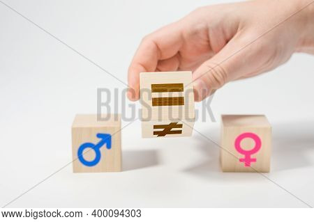 Gender Equality Concept On Wooden Cubes. Concepts Of Gender Equality. Hand Flip Wooden Cube With Sym
