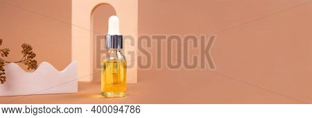 Banner With Dropper Bottle Of Natural Organic Cosmetics - Hyaluronic Acid, Serum, Moisturizer Or Fac