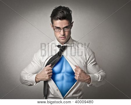 Office worker with glasses opening his shirt like a superhero
