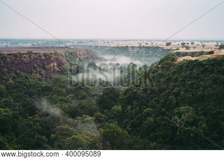 Kyambura Gorge In Queen Elisabeth National Park, A Foggy Rainforest Valley, Valley Of Apes In Uganda