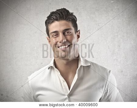 Portrait of a smiling young man in white shirt