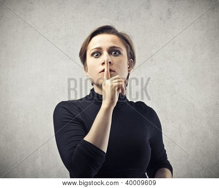 Woman making the sign of the silence