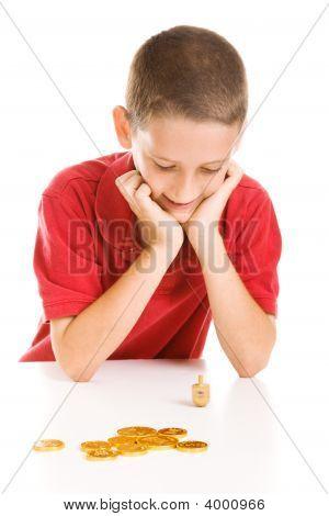 Boy Playing Dreidel