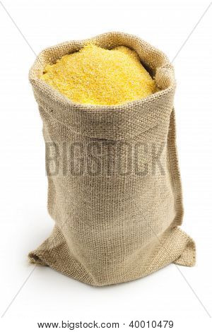 canvas bag with cornmeal isolated on white background
