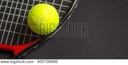 Tennis Racket With Tennis Balls In Green Color, Isolated On The Black Background, Lighting Detail Sp
