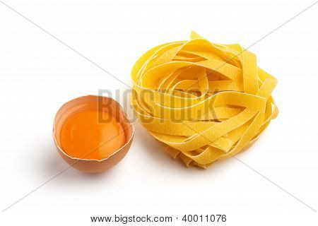 italian pasta and half egg on white background